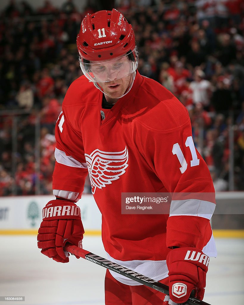 Dan Cleary of the Detroit Red Wings pauses for a moment during a NHL game against the Vancouver Canucks at Joe Louis Arena on February 24 2013 in...