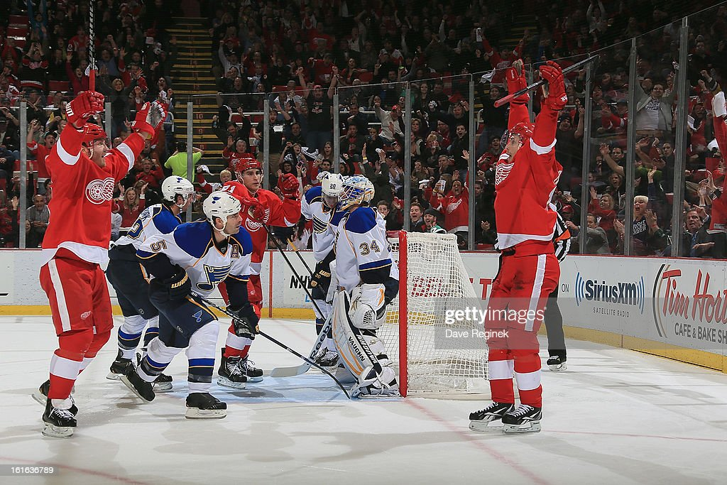 Dan Cleary #11 of the Detroit Red Wings raises his arms after teammate <a gi-track='captionPersonalityLinkClicked' href=/galleries/search?phrase=Pavel+Datsyuk&family=editorial&specificpeople=202893 ng-click='$event.stopPropagation()'>Pavel Datsyuk</a> #13 scores a second period goal to tie the game agaist the St Louis Blues at Joe Louis Arena on February 13, 2013 in Detroit, Michigan.