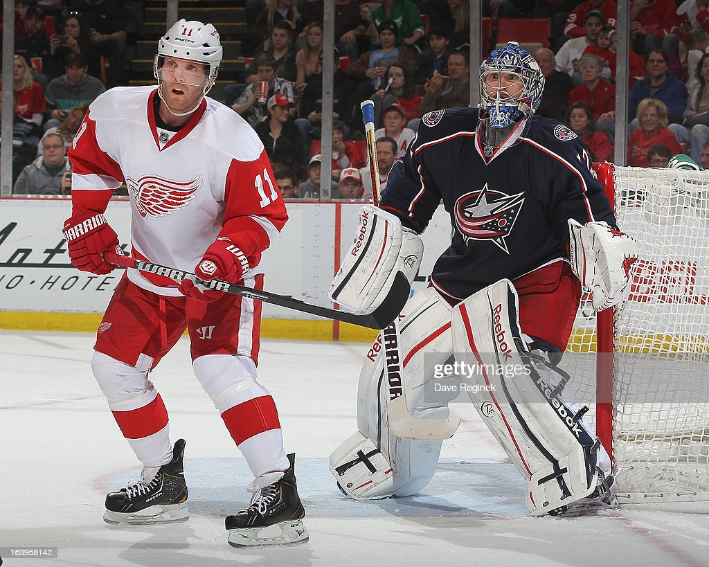 Dan Cleary of the Detroit Red Wings sets up in front of Sergei Bobrovsky of the Columbus Blue Jackets during an NHL game at Joe Louis Arena on March...
