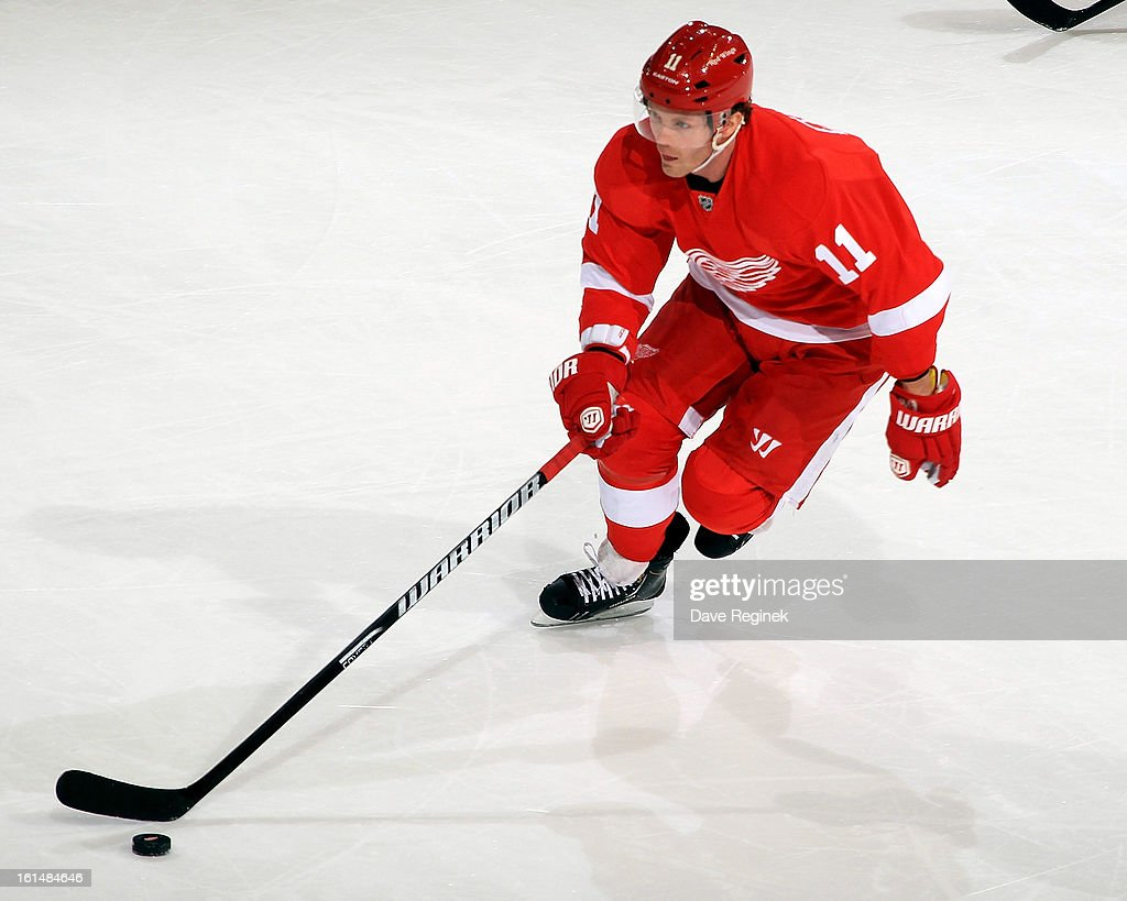 Dan Cleary of the Detroit Red Wings skates up ice with the puck during a NHL game against the Los Angeles Kings at Joe Louis Arena on February 10...