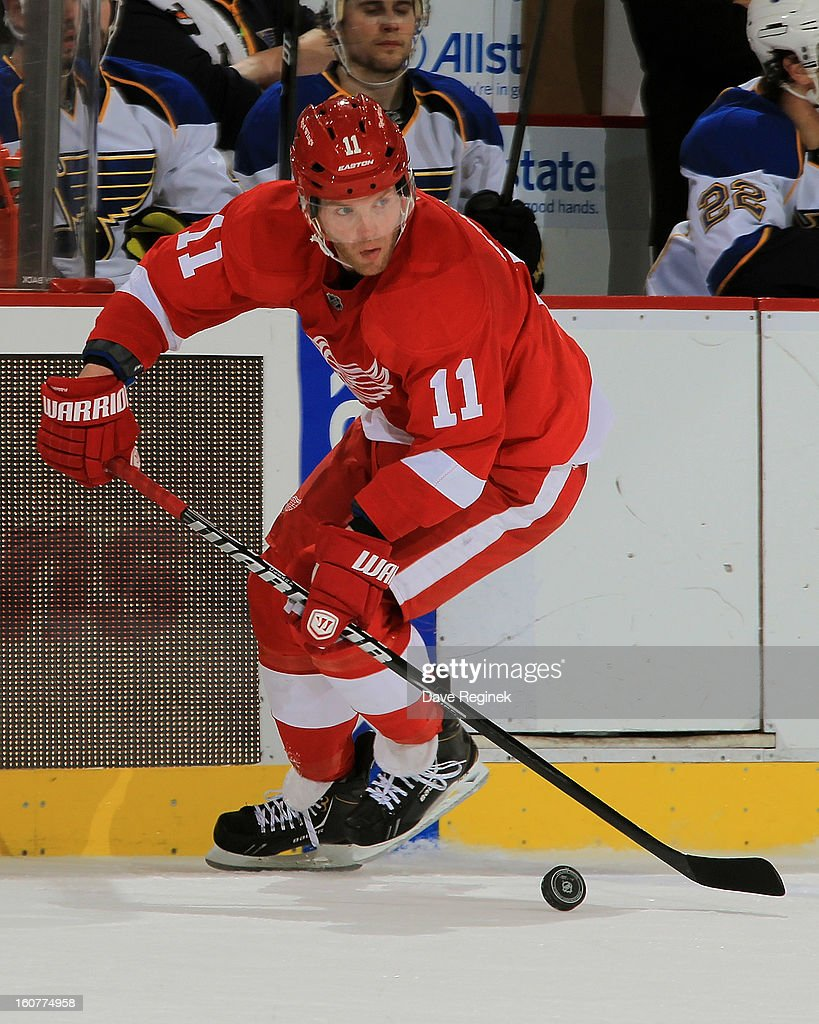 Dan Cleary of the Detroit Red Wings skates with the puck during a NHL game against the St Louis Blues at Joe Louis Arena on February 1 2013 in...