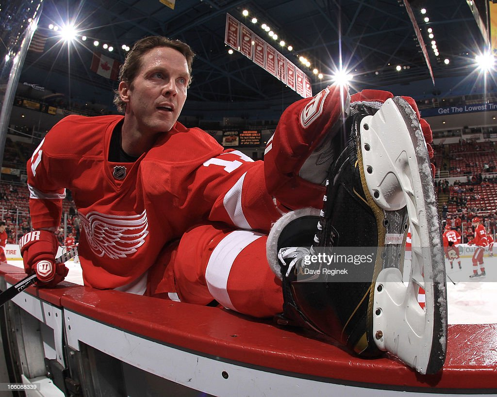 Dan Cleary of the Detroit Red Wings stretches in warmups before a NHL game against the Colorado Avalanche at Joe Louis Arena on April 1 2013 in...