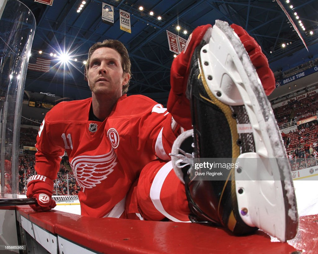 Dan Cleary of the Detroit Red Wings wears jersey in honor of Gordie Howe on his 85th birthday during warm ups before a NHL game against the Chicago...