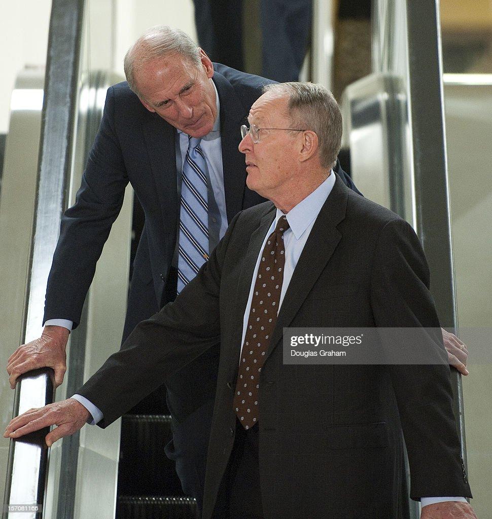 Dan Coats, R-IN and Lamar Alexander, R-TN., talk as they walk through the Senate Subway in the U.S. Capitol on November 28, 2012.