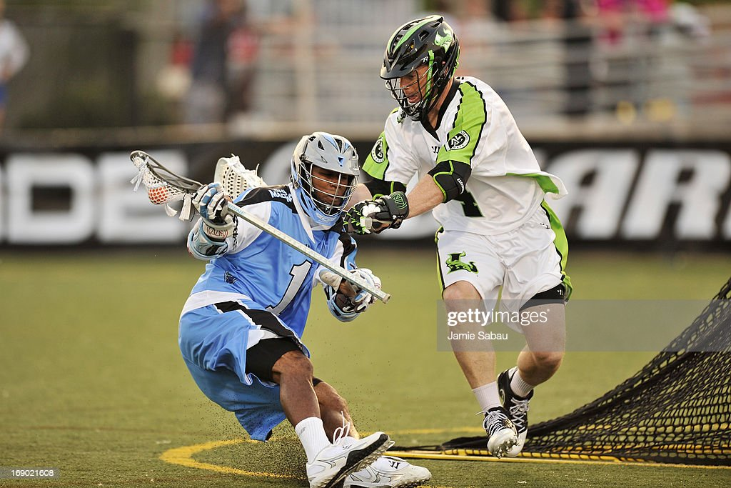 Dan Cocchi #4 of the New York Lizards defends against Chazz Woodson #1 of the Ohio Machine behind the net in the first period on May 18, 2013 at Selby Stadium in Delaware, Ohio.