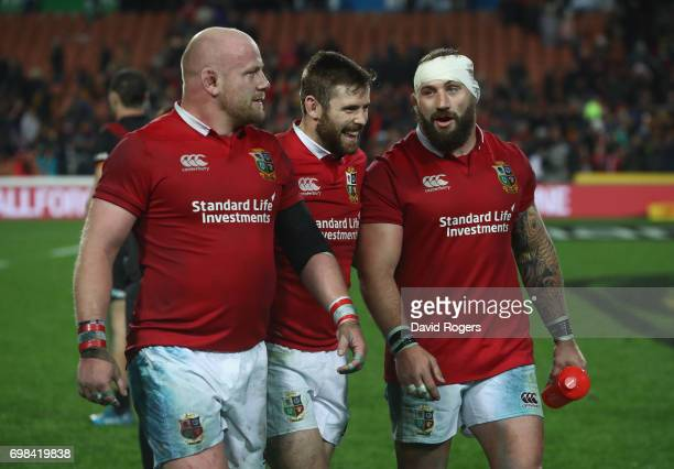 Dan Cole Elliot Daly and Joe Marler of the Lions celebrate after their victory during the match between the Chiefs and the British Irish Lions at...