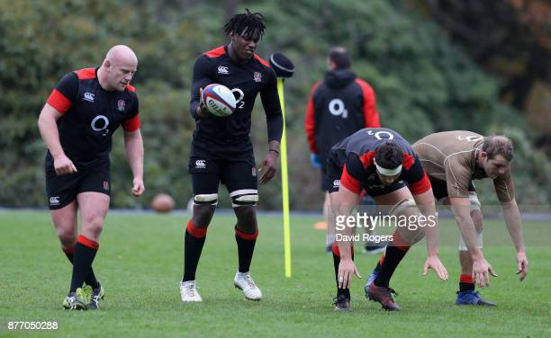 Dan Cole Maro Itoje Charlie Ewels and Joe Launchbury warm up during the England training session held at Pennyhill Park on November 21 2017 in...