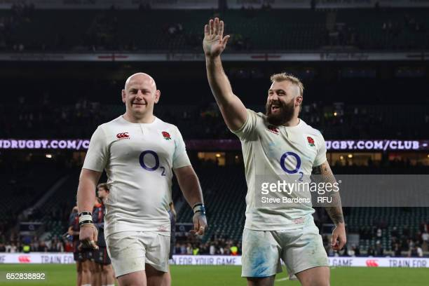 Dan Cole of England and Joe Marler of England celebrates following their team's 6121 victory during the RBS Six Nations match between England and...