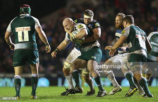 Dan Cole of Leicester is tackled by Tom Ellis during the Aviva Premiership match between Leicester Tigers and Bath at Welford Road on November 29...