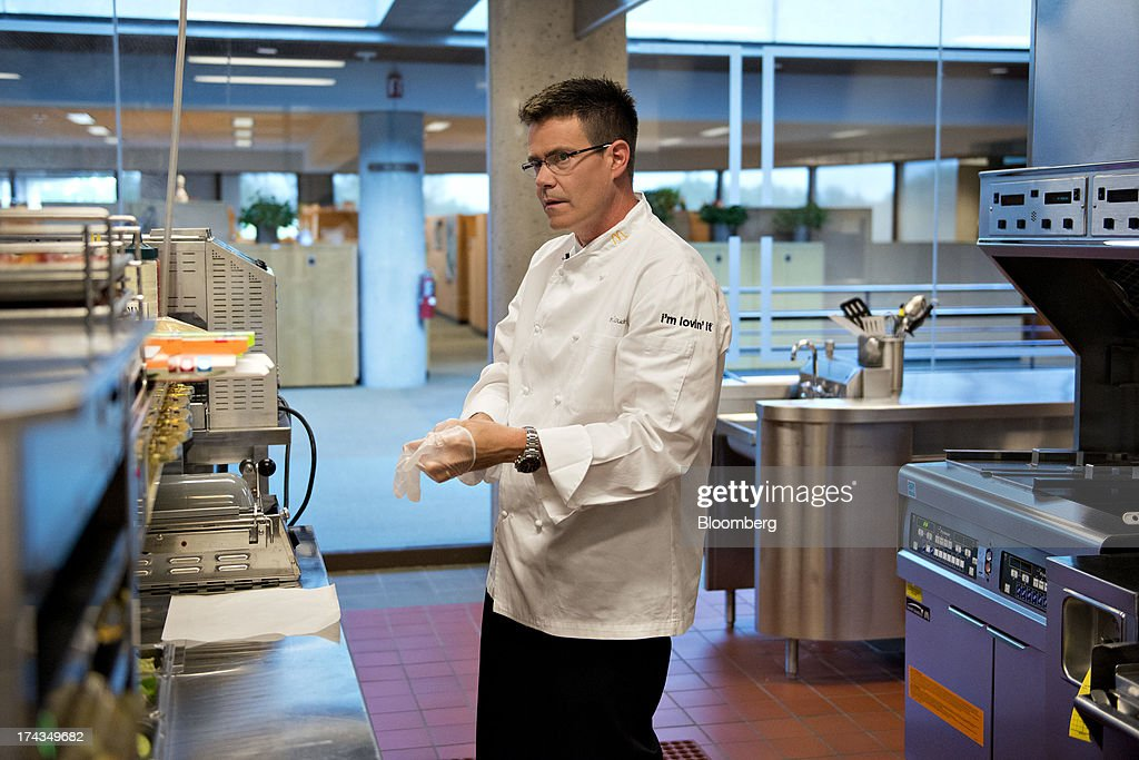 Dan Coudreaut, executive chef and director of culinary innovation for McDonald's Corp., puts on a glove as he works in a test kitchen at McDonald's headquarters in Oak Brook, Illinois, U.S., on Tuesday, July 23, 2013. Coudreaut graduated from the Culinary Institute of America at the top of his class, ran the kitchen at the Four Seasons Resort and Club in Dallas and joined McDonalds in 2004. Photographer: Daniel Acker/Bloomberg via Getty Images