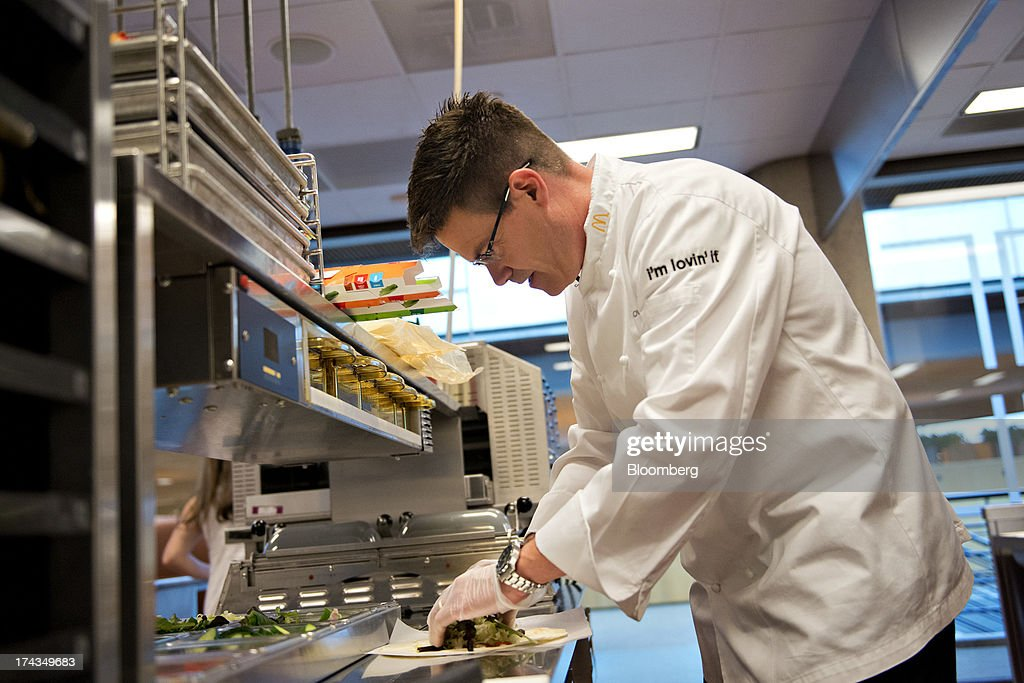 Dan Coudreaut, executive chef and director of culinary innovation for McDonald's Corp., prepares a McWrap in a test kitchen at McDonald's headquarters in Oak Brook, Illinois, U.S., on Tuesday, July 23, 2013. Coudreaut graduated from the Culinary Institute of America at the top of his class, ran the kitchen at the Four Seasons Resort and Club in Dallas and joined McDonalds in 2004. Photographer: Daniel Acker/Bloomberg via Getty Images