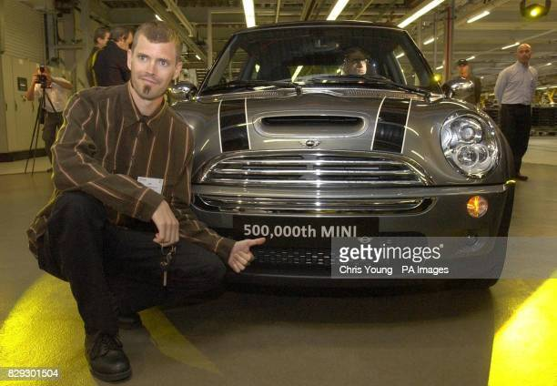 Dan Cowdry a 35 year old automotive paint salesman from West Lake Village Los Angeles California poses proudly in his new Mini Cooper as it comes off...