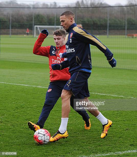 Dan Crowley and Kieran Gibbs of Arsenal during a training session at London Colney on March 18 2016 in St Albans England
