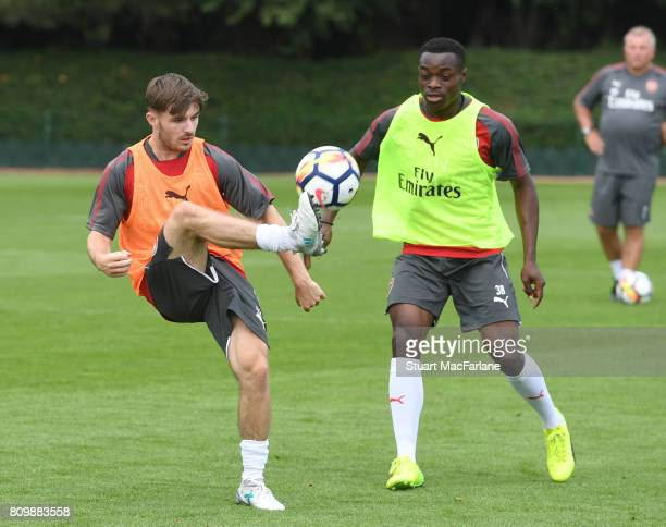Dan Crowley and Marc Bola of Arsenal during a training session at London Colney on July 6 2017 in St Albans England