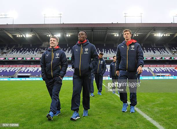 Dan Crowley Marc Bola and Krystian Bielik of Arsenal checks out the stadium before the match between Anderlecht and Arsenal at Constant Vanden Stock...