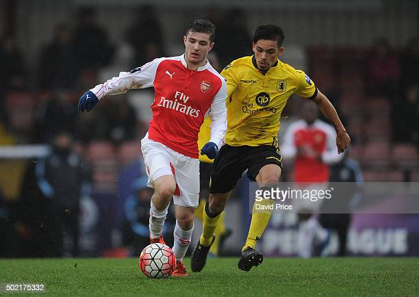 Dan Crowley of Arsenal takes on Niall Mason of Villa during the match between Arsenal U21 and Aston Villa U21 at Meadow Park on December 21 2015 in...