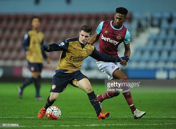 Dan Crowley of Arsenal takes on Reece Oxford of West Ham during match between West Ham United U21 and Arsenal U21 at Boleyn Ground on December 14...