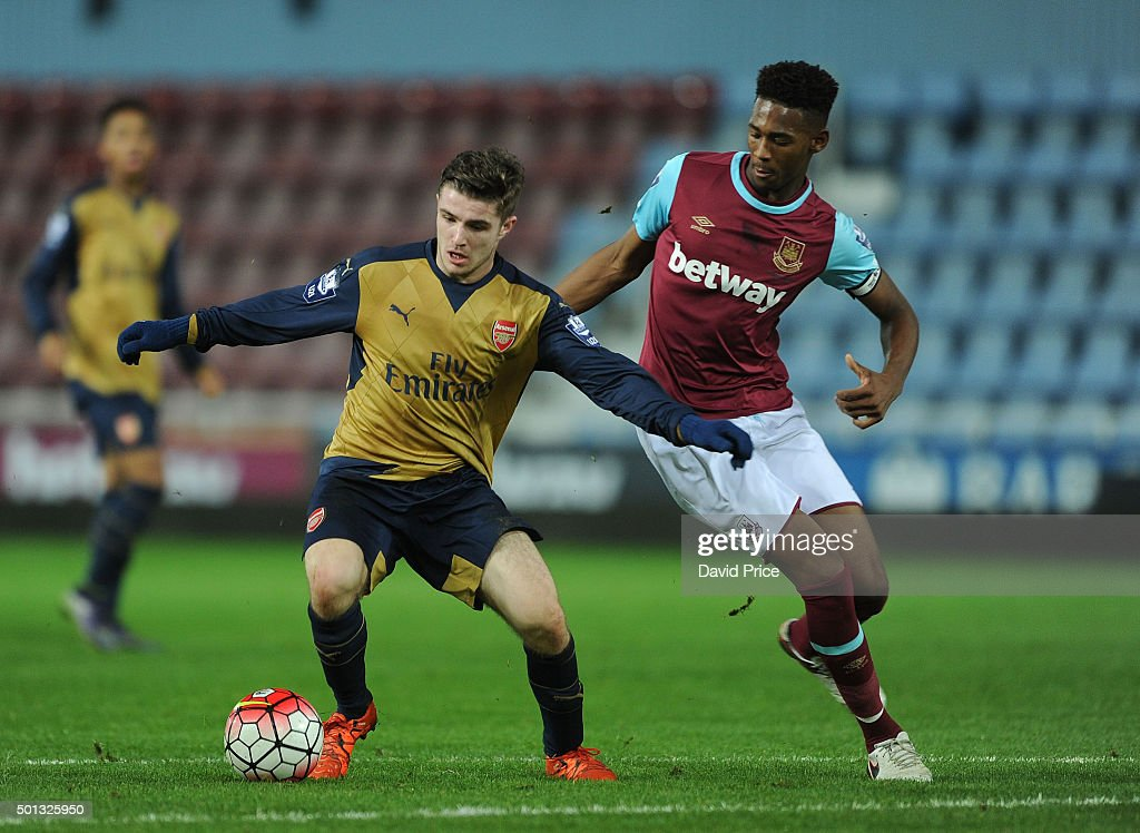 Dan Crowley of Arsenal takes on Reece Oxford of West Ham during match between West Ham United U21 and Arsenal U21 at Boleyn Ground on December 14, 2015 in London, England.