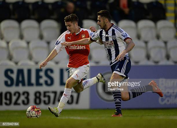 Dan Crowley of Arsenal takes on Robbie McCourt of WBA during the match between Arsenal U21 and West bromwich Albion U21 at Meadow Park on April 18...