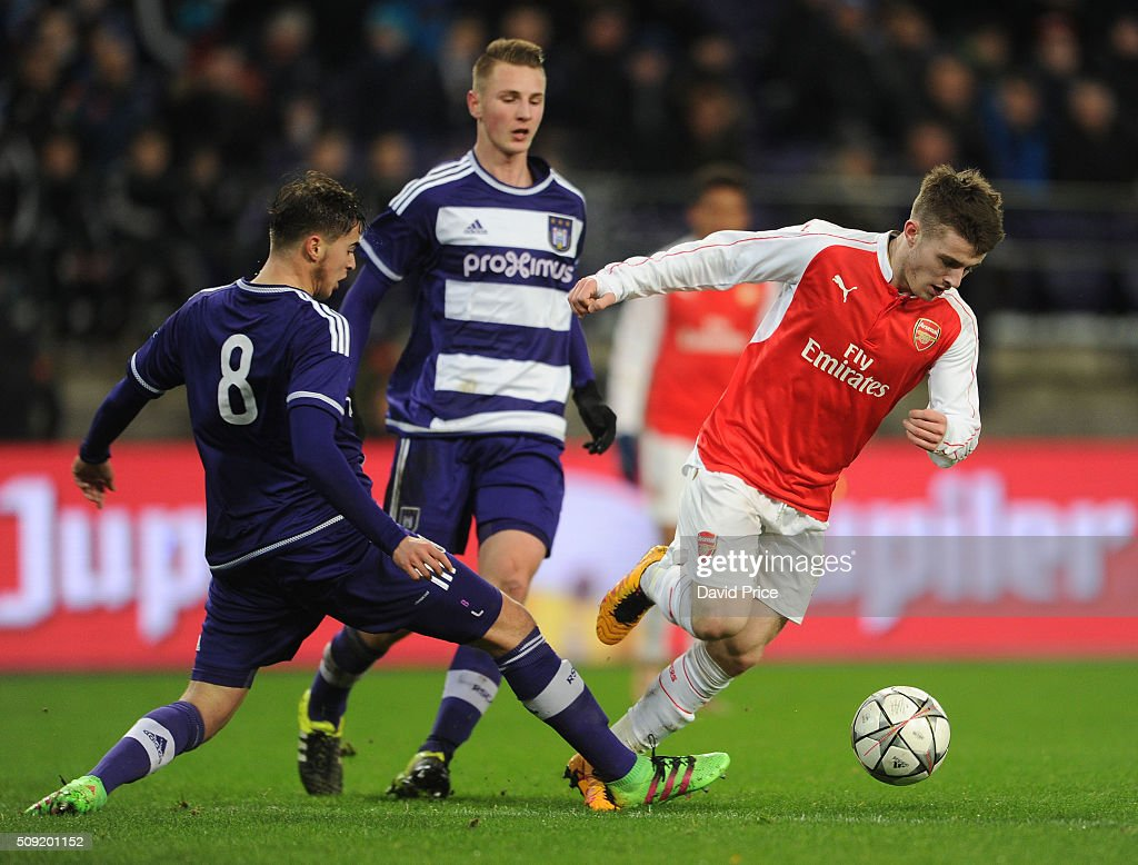 Dan Crowley of Arsenal takes on Samy Bourard of Anderlecht during the match between Anderlecht and Arsenal at Constant Vanden Stock Stadium on February 9, 2016 in Brussels, Bruxelles-Capitale, Region de.