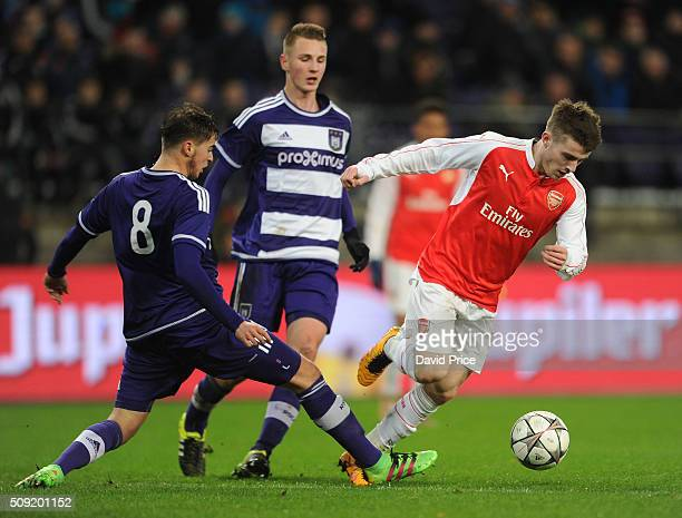 Dan Crowley of Arsenal takes on Samy Bourard of Anderlecht during the match between Anderlecht and Arsenal at Constant Vanden Stock Stadium on...