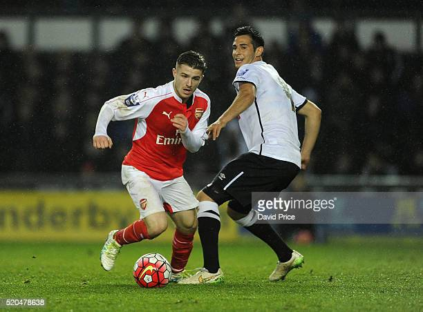 Dan Crowley of Arsenal takes on Tom Koblenz of Derby during the Barclays U21 Premier League match between Derby County U21 and Arsenal U21 at iPro...