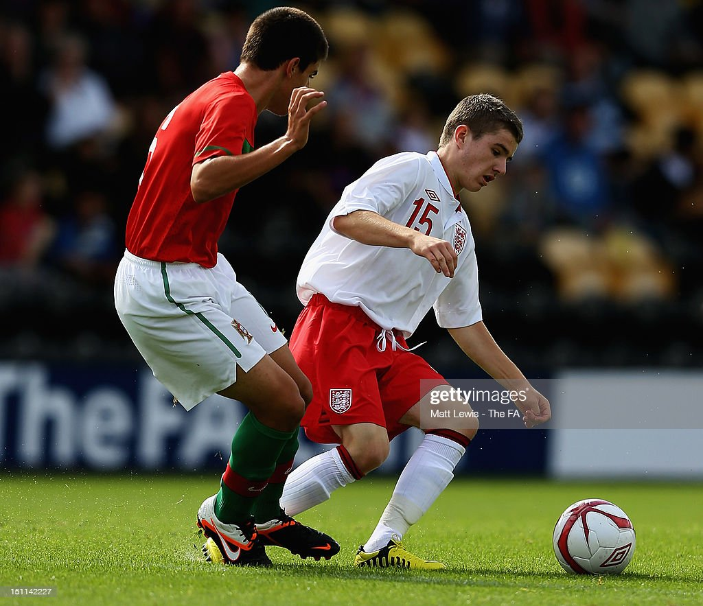 Dan Crowley of England and Ruben Neves of Portugal challenge for the ball during the match between England U17 and Portugal U17 at Pirelli Stadium on September 2, 2012 in Burton-upon-Trent, England.