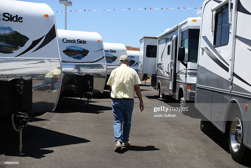 Dan Daniel tours the sales lot at Cordelia RV on May 29, 2013 in Fairfield, California. Deliveries of motor homes and towable RVs to dealers surged 11 percent in the first quarter and the RV industry anticipates a total of 307,300 units will be shipped this year, the highest number since 2007.