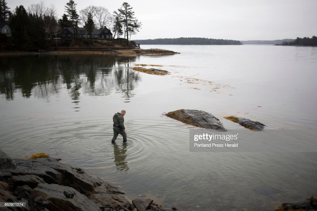 Dan Devereaux walks out in the water at Mere Point Boat Launch. Devereaux is the Marine Resource Officer and Harbor Master for the town of Brunswick.