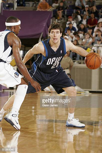 Dan Dickau of the Dallas Mavericks faces Jason Terry during an intrasquad exhibition at the Mavs Fan Jam on October 9 2004 at Texas Christian...