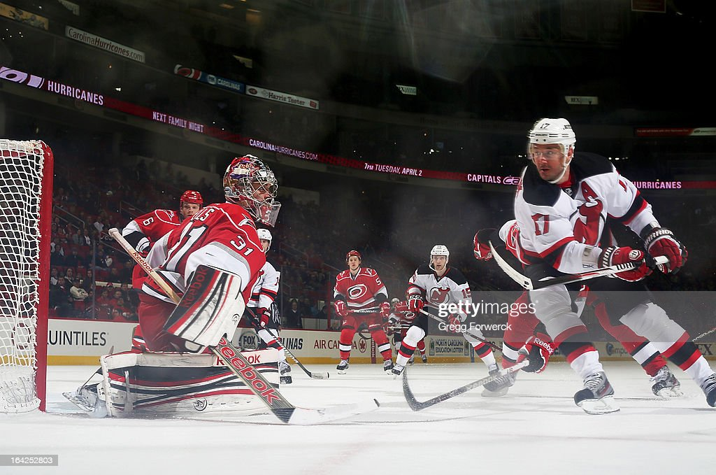 <a gi-track='captionPersonalityLinkClicked' href=/galleries/search?phrase=Dan+Ellis&family=editorial&specificpeople=2235265 ng-click='$event.stopPropagation()'>Dan Ellis</a> #31 of the Carolina Hurricanes goes down in the crease to make a save on a shot by <a gi-track='captionPersonalityLinkClicked' href=/galleries/search?phrase=Ilya+Kovalchuk&family=editorial&specificpeople=201796 ng-click='$event.stopPropagation()'>Ilya Kovalchuk</a> #17 of the New Jersey Devils during their NHL game at PNC Arena on March 21, 2013 in Raleigh, North Carolina.
