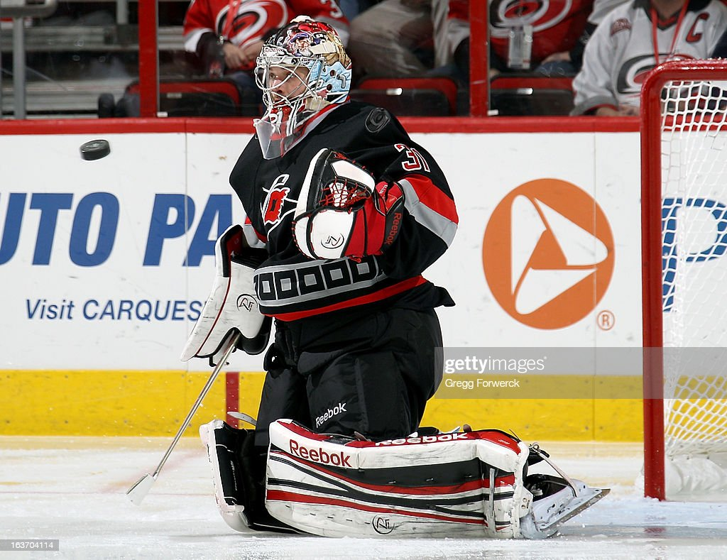 <a gi-track='captionPersonalityLinkClicked' href=/galleries/search?phrase=Dan+Ellis&family=editorial&specificpeople=2235265 ng-click='$event.stopPropagation()'>Dan Ellis</a> #31 of the Carolina Hurricanes keeps his eye on the puck following a Washington Capitals' shot during their NHL game at PNC Arena on March 14, 2013 in Raleigh, North Carolina.
