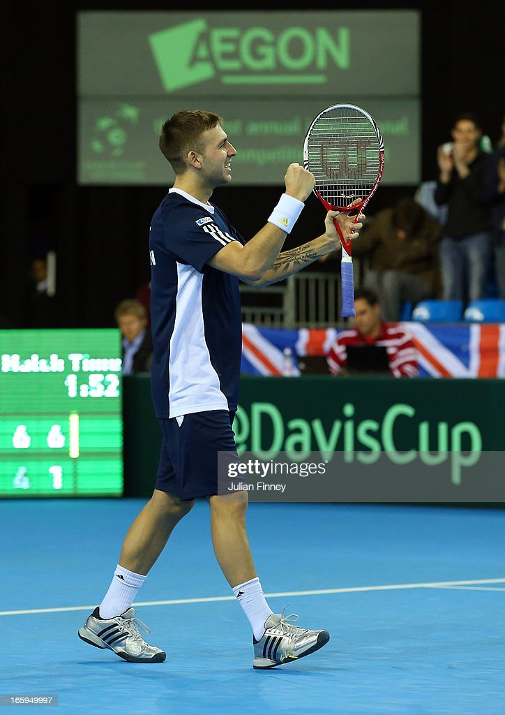 Dan Evans celebrates at match point after his straight sets victory over Evgeny Donskoy of Russia during day three of the Davis Cup match between Great Britain and Russia at the Ricoh Arena on April 7, 2013 in Coventry, England.