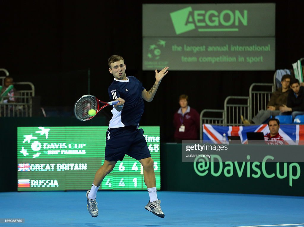 Dan Evans in action against Evgeny Donskoy of Russia during day three of the Davis Cup match between Great Britain and Russia at the Ricoh Arena on April 7, 2013 in Coventry, England.