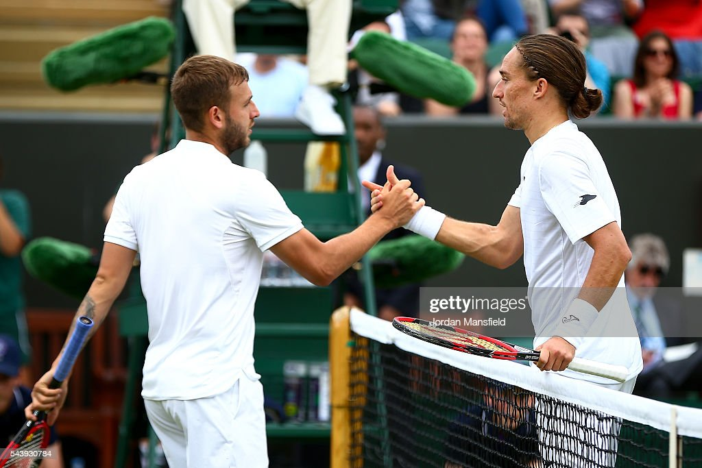 <a gi-track='captionPersonalityLinkClicked' href=/galleries/search?phrase=Dan+Evans+-+Tennis+Player&family=editorial&specificpeople=10807404 ng-click='$event.stopPropagation()'>Dan Evans</a> of Great Britain (L) celebrates victory during the Men's Singles second round match against <a gi-track='captionPersonalityLinkClicked' href=/galleries/search?phrase=Alexandr+Dolgopolov&family=editorial&specificpeople=7025085 ng-click='$event.stopPropagation()'>Alexandr Dolgopolov</a> of Ukraine (R) on day four of the Wimbledon Lawn Tennis Championships at the All England Lawn Tennis and Croquet Club on June 30, 2016 in London, England.
