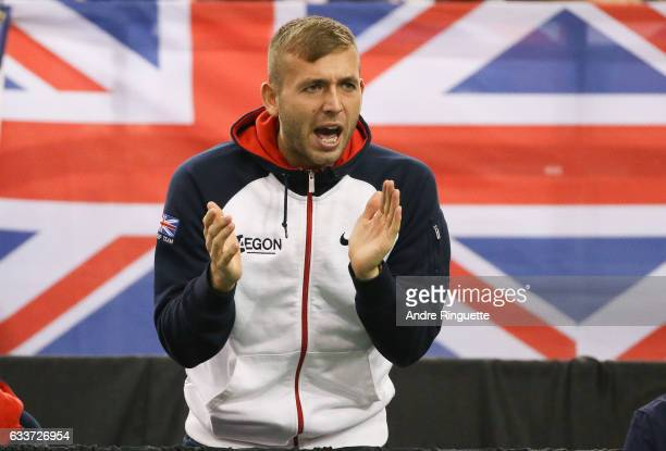 Dan Evans of Great Britain cheers on his teammate Kyle Edmund in his singles match against Vasek Pospisil of Canada during day one of the Davis Cup...