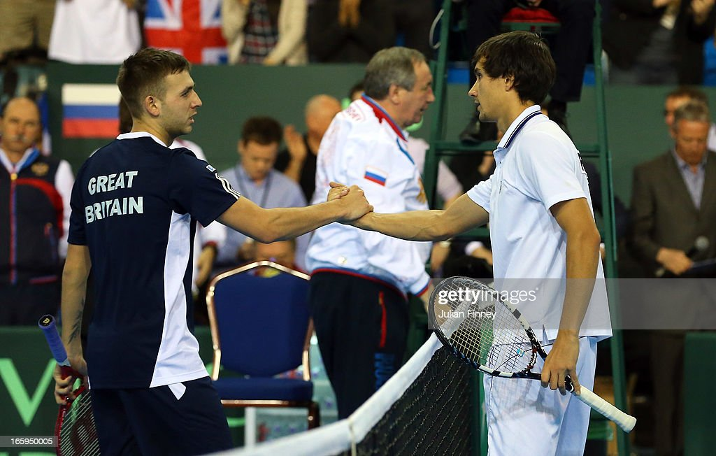 Dan Evans of Great Britain is congratulated by Evgeny Donskoy of Russia after Evans won in straight sets during day three of the Davis Cup match between Great Britain and Russia at the Ricoh Arena on April 7, 2013 in Coventry, England.