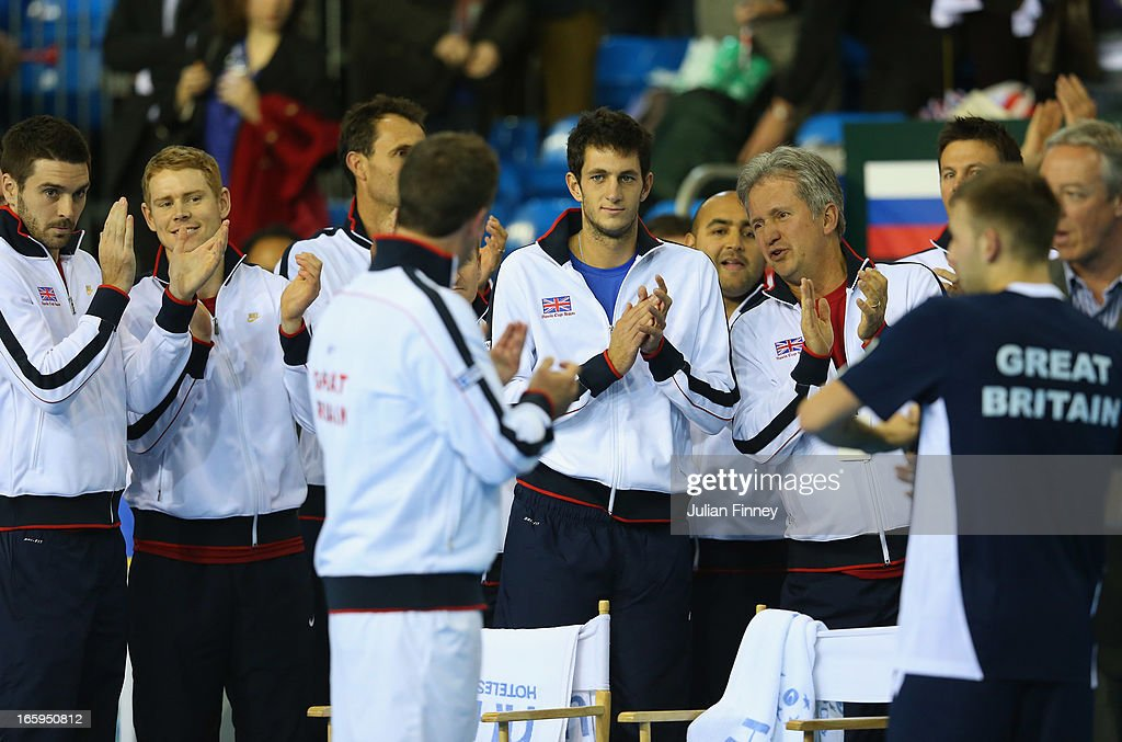 Dan Evans of Great Britain is interviewed as team GB watch on after their win over Russia during day three of the Davis Cup match between Great Britain and Russia at the Ricoh Arena on April 7, 2013 in Coventry, England.