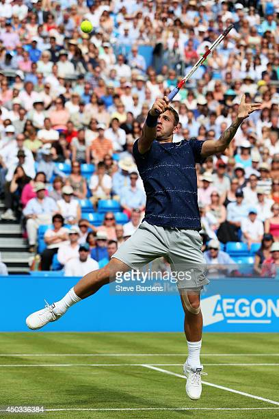 Dan Evans of Great Britain plays a overhead shot during his victory over Jurgen Melzer of Austria in their Men's Singles match on day one of the...