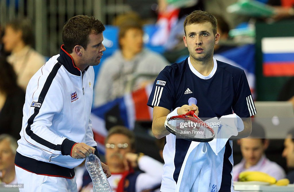 Dan Evans of Great Britain receives support from Captain Leon Smith against Evgeny Donskoy of Russia during day three of the Davis Cup match between Great Britain and Russia at the Ricoh Arena on April 7, 2013 in Coventry, England.