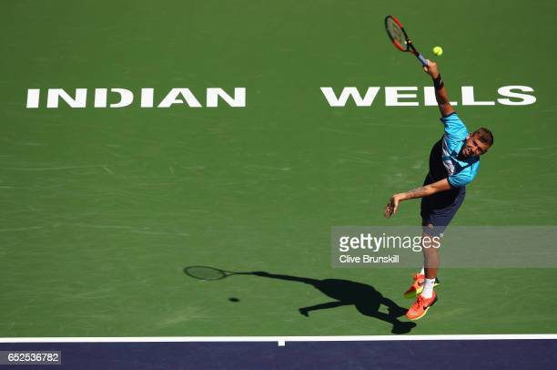 Dan Evans of Great Britain serves against Kei Nishikori of Japan in their second round match during day seven of the BNP Paribas Open at Indian Wells...