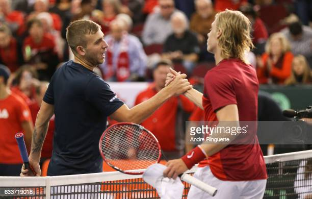 Dan Evans of Great Britain shakes hands after his singles match win against Denis Shapovalov of Canada during day one of the Davis Cup World Group...
