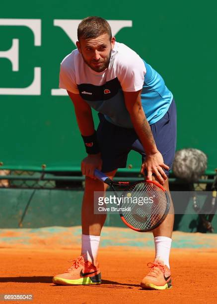 Dan Evans of Great Britain shows his dejection during his straight sets defeat by Kyle Edmund of Great Britain in their first round match on day two...