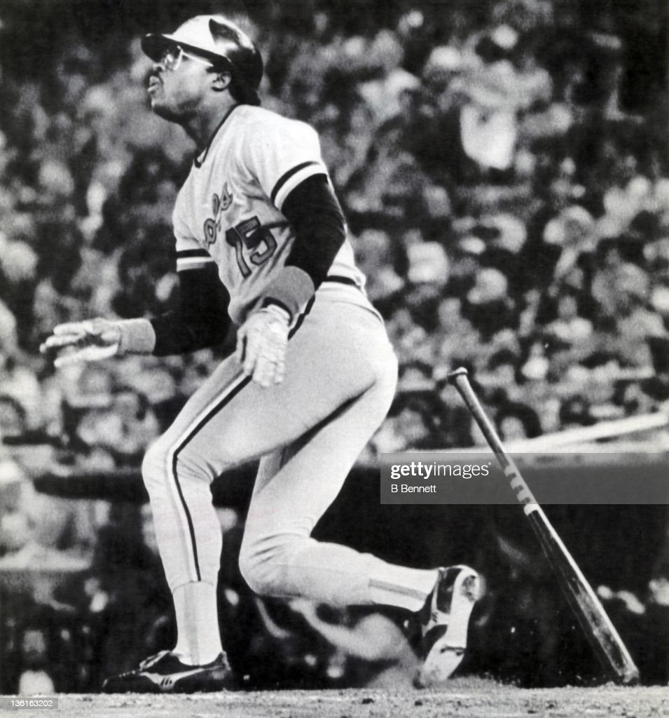 Dan Ford of the Baltimore Orioles watches the flight of him home run in the sixth inning of Game 3 in the 1983 World Series against the Philadelphia...