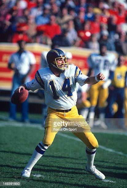Dan Fouts of the San Diego Chargers drops back to pass against the San Francisco 49ers during an NFL football game December 11 1982 at Candlestick...