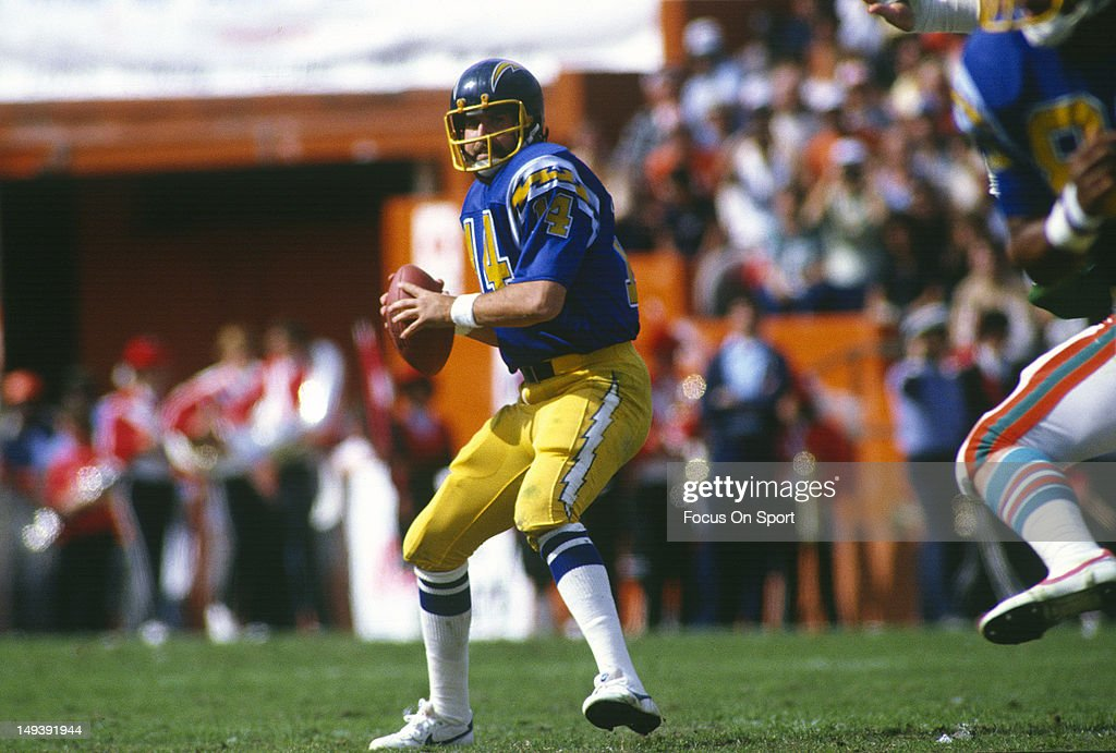 <a gi-track='captionPersonalityLinkClicked' href=/galleries/search?phrase=Dan+Fouts&family=editorial&specificpeople=228594 ng-click='$event.stopPropagation()'>Dan Fouts</a> #14 of the San Diego Chargers drops back to pass against the Miami Dolphins during the AFC Divisional Playoff NFL football game January 16, 1983 at the Orange Bowl in Miami, Florida. Fouts played for the Chargers from 1973-87.