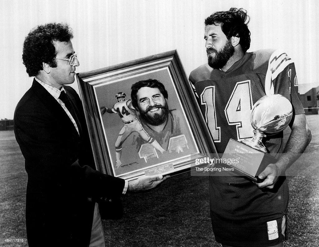 <a gi-track='captionPersonalityLinkClicked' href=/galleries/search?phrase=Dan+Fouts&family=editorial&specificpeople=228594 ng-click='$event.stopPropagation()'>Dan Fouts</a> of the San Diego Chargers is presented with a painting of himself circa 1980s.