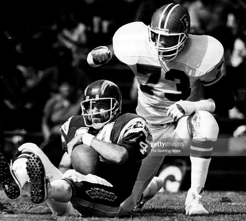 Dan Fouts of the San Diego Chargers is tackled circa 1980s.