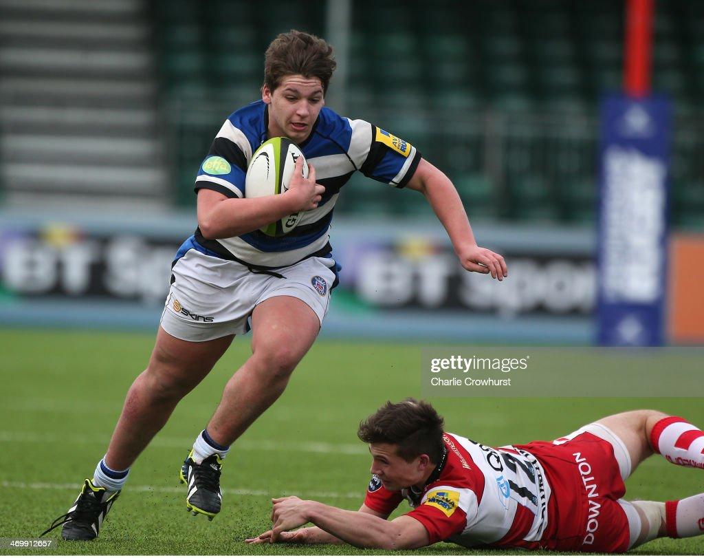 Dan Frost of Bath skips the tackle from Gloucester's Charlie Norman during the The U18 Academy Finals Day match between Bath and Gloucester at...