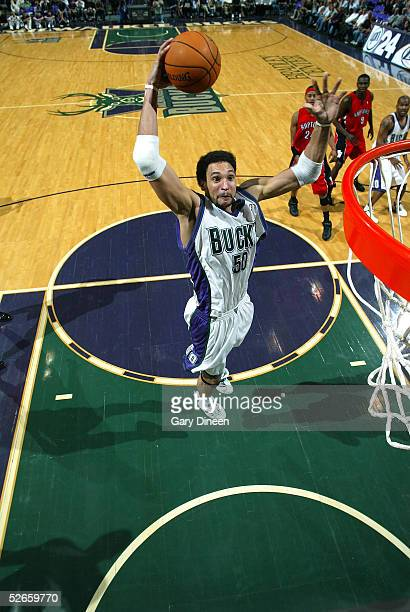 19 Dan Gadzuric of the Milwaukee Bucks dunks against the Toronto Raptors on April 19 2005 at the Bradley Center in Milwaukee Wisconsin NOTE TO USER...